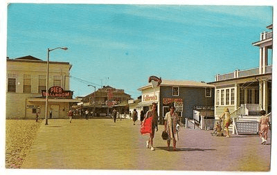 People walking down the ocean city boardwalk in 1950