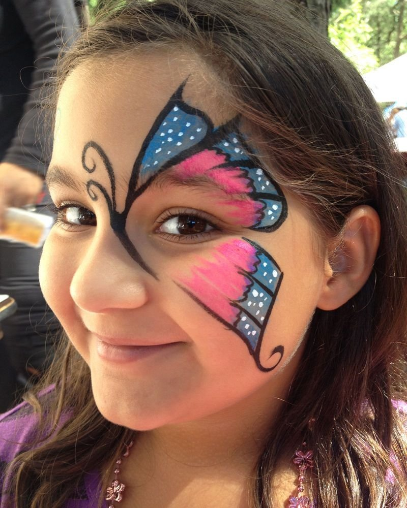Girl with butterfly face painted