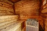 inside a wooden sauna with a bench