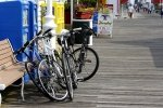 bikes laying against a bench on a boardwalk