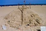 sand scupture of Jesus that says 'thank you Jesus'